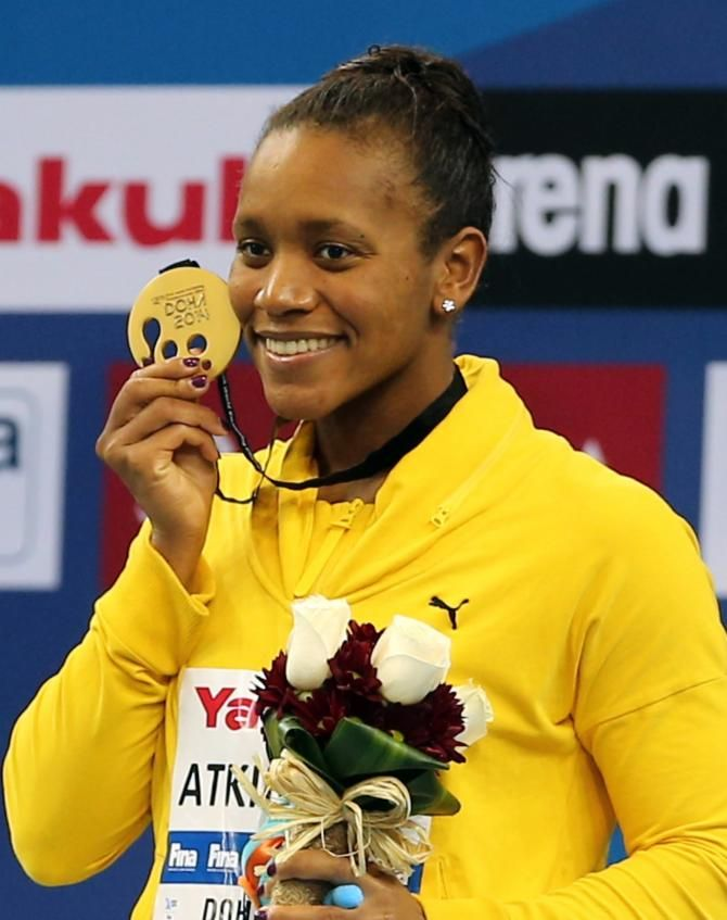Alia Atkinson made swimming history on Saturday by becoming the first black woman to win a world swimming title: the women's 100 breaststroke at the world short-course championships in Doha, Qatar....