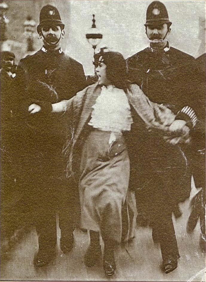 Sixteen-year-old suffragette Dora Thewlis is arrested by two policemen on 20 March 1907. And it looks like the about ripped her skirt off.