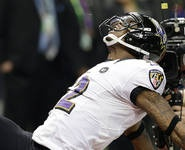 After power outage, Ravens stay plugged in, hold off Niners for  title.