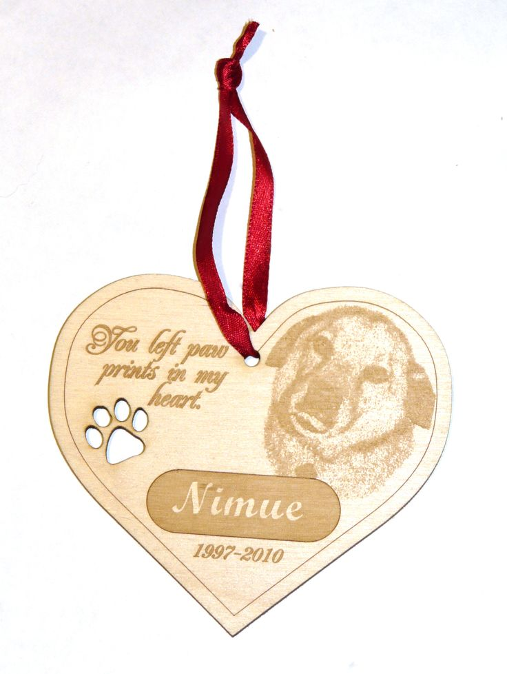 Custom ornament with paw print cutout commemorating the life of one of our favorite pooches.