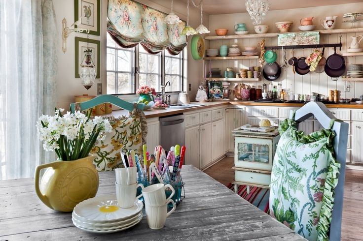Whimsical whimsical whimsical. I get lost in this intricate and intimate vintage eclectic kitchen.   See more: http://www.whitetailvintage.com/blog/vintage-eclectic-let-your-funk-flag-fly/