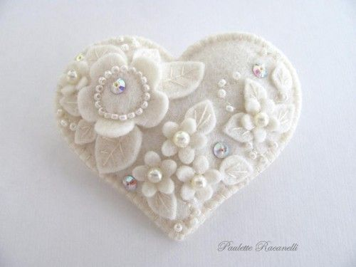 White felt heart with pearls - the wholecloth quilt of felt. Nifty ideas for decoration here, would it scale up well to, say, a couch pillow? ~cww