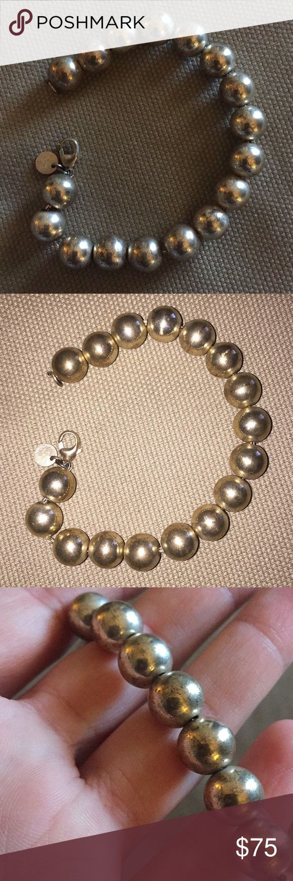 """Tiffany & Co Ball (bead) bracelet Silver authentic Tiffany & Co bracelet. Definitely needs to be cleaned! Please examine the pictures closely as the beads look somewhat distressed or faded. That's why I'm listing it at this low price! 7.5""""  I got it as a bridesmaid gift and only wore it for the wedding! It's been in my jewelry box ever since. Tiffany & Co. Jewelry Bracelets"""