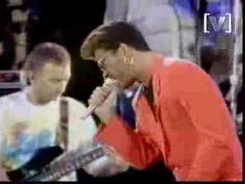 """George Michael singing """"Somebody to Love"""" at the Freddie Mercury Tribute. George Michael's life has been a horrific circus but the man can SING! I absolutely love this and judging from his smile, so did the guitarist Brian May. George Michael definitely was channeling Freddie."""