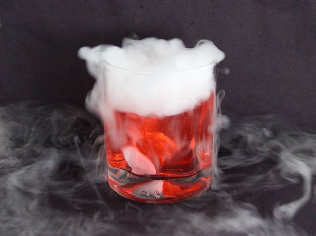 A deliciously spooky way to toast Halloween, our Bubbling and Bloody Witch& Brew cocktail is made with club soda, rum, grenadine and an ice-cube-sized chunk of dry ice. Dry Ice Halloween, Adult Halloween Party, Halloween Treats, Halloween Desserts, Halloween Foods, Halloween Decorations, Halloween 2020, Happy Halloween, Spooky Decor