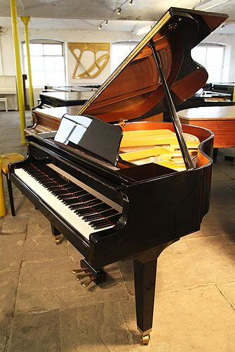 A 1975, Yamaha GA1 baby grand piano for sale with a black case and spade legs. Piano has three pedals and eighty-eight notes -at Besbrode Pianos