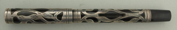 Offered is a Waterman 414 PSF. It is all original and in near mint condition with no flaws to mention. This model is amongst the rarest that Waterman produced and was made for approximately one year(1913).The pen fills by placing a coin in the slot and depressing the pressure bar.  Waterman offered a special oval coin with the Waterman logo on it but any coin will do.The pen has raised barrel threads typical of all the pens in the PSF series. The nib is a Waterman #2 Medium with a bit of…