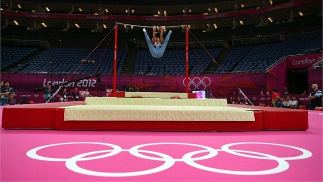 Louis Smith of Great Britain performs on the horizontal bar during the men's Artistic Gymnastics training session at the North Greenwich Arena.
