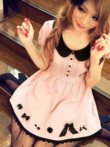 Cute, sweet gyaru: Light pink dress with black details and black collar. Black, sheer tights with black dots. Black hair accessory. Black heels.