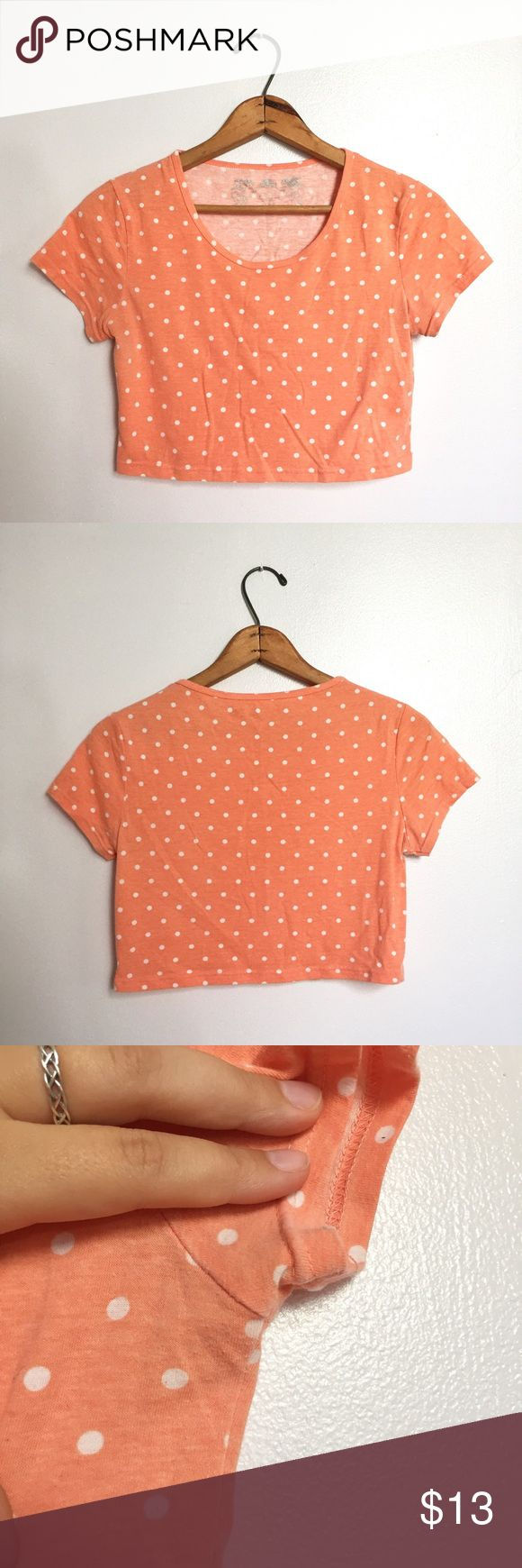"Peach & white polka dot crop top - Size: L - Condition: some very faint pilling in the armpit area, not seen when worn or really at all - Color: peach and white - Pockets: no - Lined: no - Closure: none - Style: polka dot crop top - Extra notes: bust is approx 16.5"" flat, length is approx 14.75"" Poof! Tops Crop Tops"