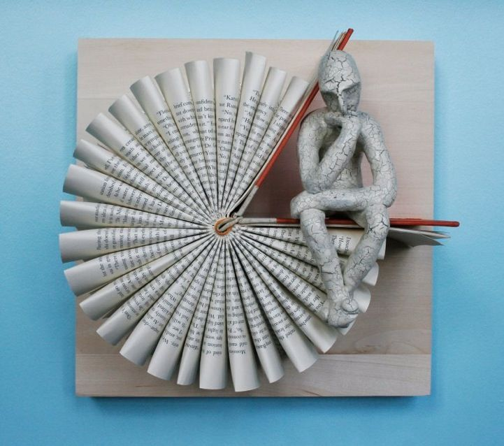 Malaysia-born, Tennessee-based artist Daniel Lai, aka Kenjio, uses a visually captivating paper folding technique for his inspired book sculptures