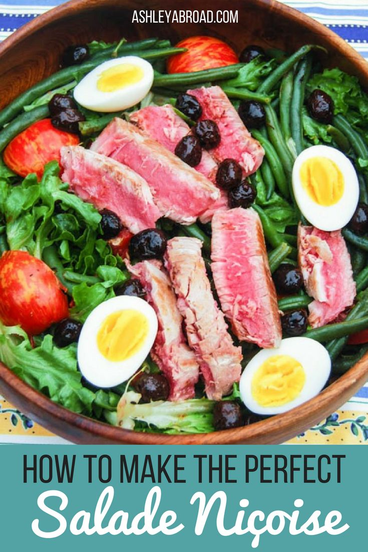 One of my favorite summer salads is Salade Niçoise. I learned this recipe in France years ago, and love it because I usually have all of the ingredients on hand: eggs, canned tuna, lettuce, green beans and tomatoes. Also, it's incredibly filling while being high in protein and low in calories. Salade Niçoise is the perfect summer lunch or light dinner. | Ashley Abroad