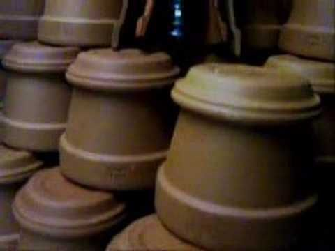 need a heater for a small room... how about a candle and some terra cotta pots...
