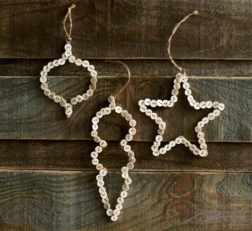 Button Ornament. Pale mother-of-pearl buttons form lightly dimensional forms of traditional ornaments and hang from jute twine. The buttons' pearlescent luster adds a quiet elegance to these outlines. Rustic Christmas Ornaments. Country Christmas.