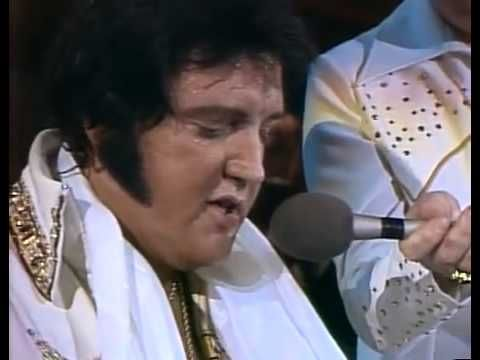 "Such a great performance. Little did Elvis know, this would be the very last concert recorded on video, from ""Elvis In Concert"". Even to the end, he gave it all his heart. He is obviously sick, but still sings so good. Here Elvis played the piano and sung Unchained Melody, giving it all his heart, for his lovely and devoted fans."