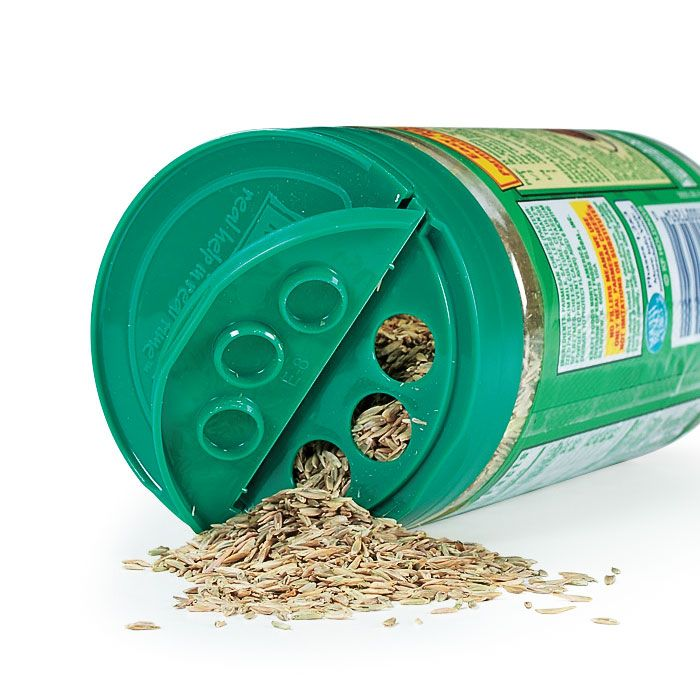 Simple Trick for Spreading Seed:  Tired of dumping out a lot of grass seed where you just need a little? Reuse an empty parmesan cheese dispenser so you won't pour out too much.  Smart Dispenser. The three-holed side of the container dispenses seeds smoothly and evenly. If you need more seeds for a big bare spot on your lawn, use the open side of the lid.