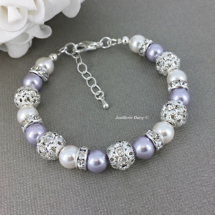 Swarovski Pearl Bracelet Lavender Bracelet Bridesmaid Bracelet Bridesmaid Gift on a budget Purple Pearl Bracelet Rhinestones Bracelet by dcjoaillerie on Etsy https://www.etsy.com/ca/listing/490908208/swarovski-pearl-bracelet-lavender