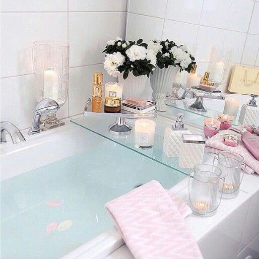 "Beautiful bath tray for the ultimate ""me"" tub. Glass tray, candles and flowers. Do the same in your tub with Candle Impressions LED candles so you can leave it unattended to surprise someone!"