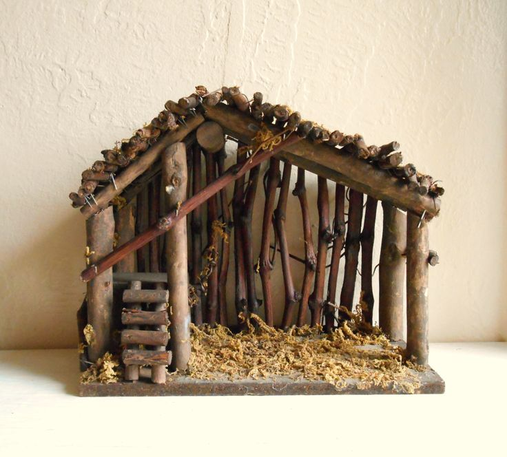 This is a wood manger ready to be set up with your nativity set for the holidays or to use as a house for another set-up. There is moss covering the