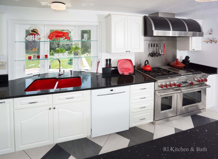 A Retro-Chic Kitchen Design by #RIKB #KitchenDesign #Kitchen #DesignBuild #StainlessSteel #Tile #Red #RedSink #Kohler #WhiteCabinetry