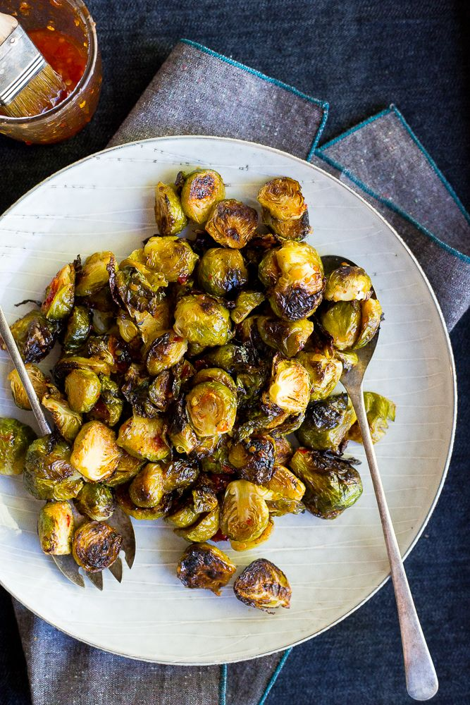 These Sweet Chili Roasted Brussels Sprouts are the perfect way to mix up your traditional brussels sprouts!  They're the perfect side dish!  Vegan and gluten free