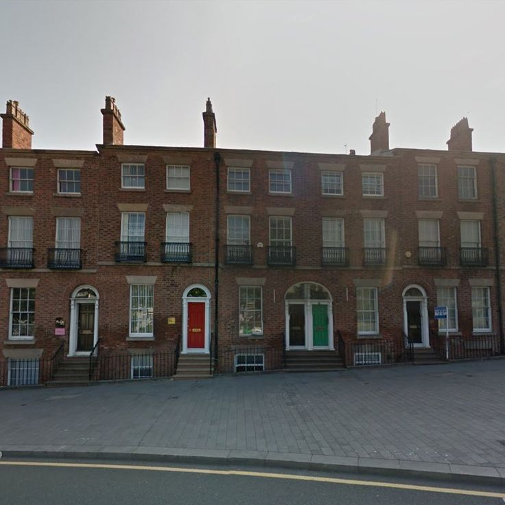 John McCall Architects, student accommodation. Refurbishment of existing red brick terrace