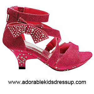 The newest look in girls fashion high  heel shoes. Textured fabric with shiny thread woven into it, rhinestone embellished  bow, crisscross ankle straps, and a zipper back complete this lovely shoe in toddler and children s sizes (9-4). This style is also available in gold and white.