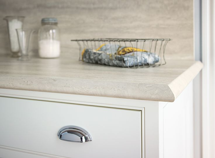 Formica 180fx 3458 Travertine Silver is perfect for a classic timeless kitchen countertop. It's paired here with white cabinets.