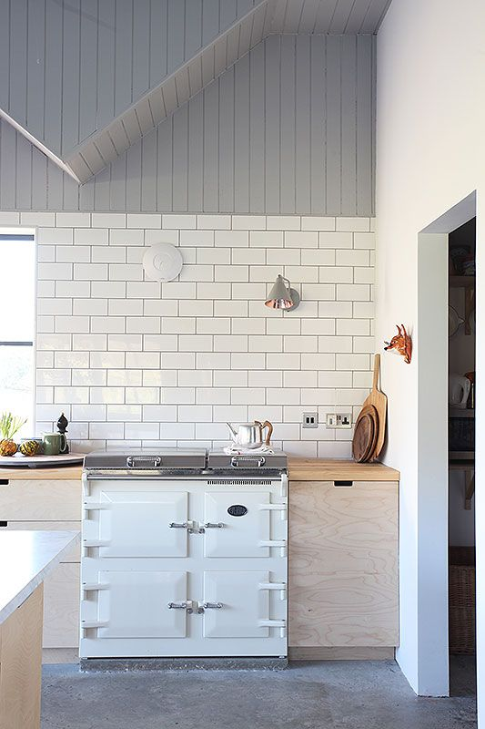 white enamel oven, pale wood kitchen