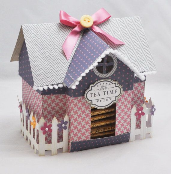 Isn't this the cutest little house you've ever seen? It's actually a gift box of sorts- a tea house cottage box filled with tea bags! Terri Moore is one talented lady :)