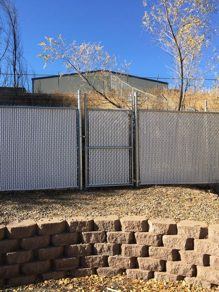 Chain Link with Barb Wire Privacy Slats and Gate. Our chain link fences are popular for commercial, residential, and industrial sites and are one of the most cost effective fence types on the market.