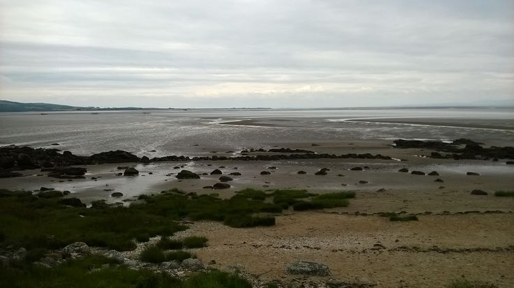 The sea going out at Portling Bay. Taken July 2014