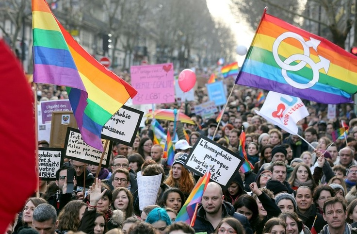 Les slogans de la manifestation pour le mariage homosexuel à Paris - #mariagepourtous - People take part in a demonstration for the legalisation of gay marriage and LGBT (lesbian, gay, bisexual, and transgender) parenting, in Paris on January 27, 2013, two days before a parliamentary debate on the government's controversial marriage equality bill, which will allow gay couples the same rights as their straight counterparts. AFP/THOMAS SAMSON