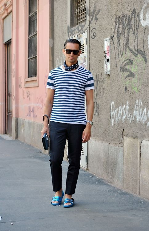 Vertical stripes can make you look bigger than you are but thin ones can actually be slimming creating an optical illusion. Milan Street Style.