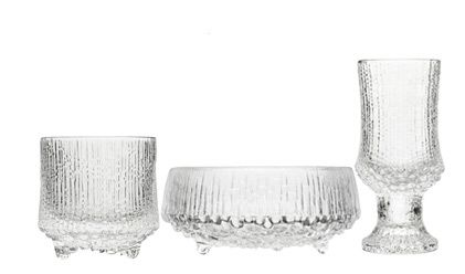 "Ultima Thule -series by Tapio Wirkkala. It is even nowdays very likely that a nostalgia-aware host will serve you Koskenkorva or Finlandia vodka from Ultima Thule shot glass. I dunno whether this qualifies as ""modest"" per se, but the context usually makes this glassware modest."