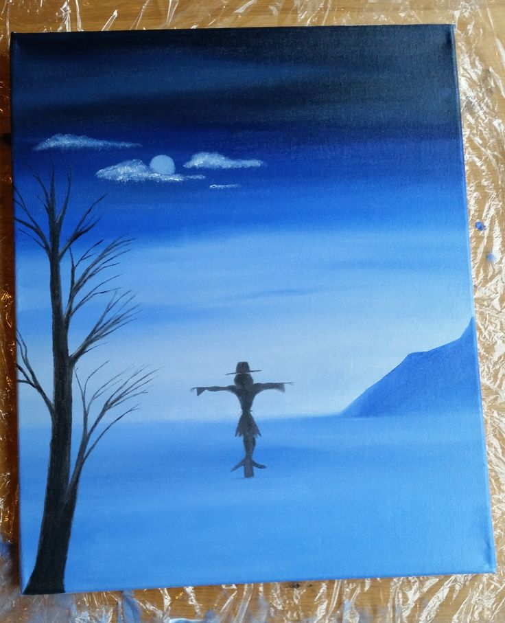 A halloween painting. A scarecrow in a blue field with a tree at night time. Painted with water soluble oil paint.