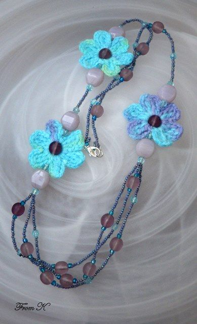 Turquoise and violet crocheted flower necklace. Made exclusively by hand from start to finish, with a thick shiny nylon thread and is unique piece. These beautiful crocheted necklace will be a unique accessory for your everyday or evening dress. Decorated with Czech glass beads and bead crystals. Very light weight. About 70 cm long.