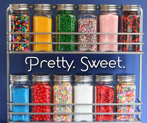 Anyone who has an entire collection of rainbow-colored sprinkles is one lucky gal. Use a spice rack and jars to keep them tidy—  and let them make a colorful statement in your kitchen. See more at Bakerella »   - HouseBeautiful.com