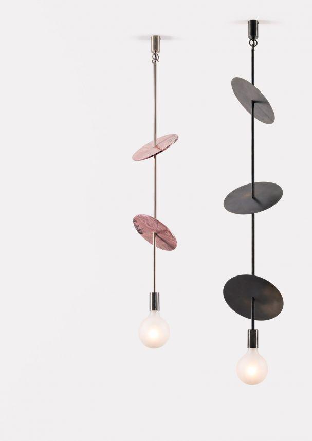 Great Spielerisch und zugleich minimalistisch Die Metall Scheiben in verschiedenen Farben lassen mehrere Kombinationen zu