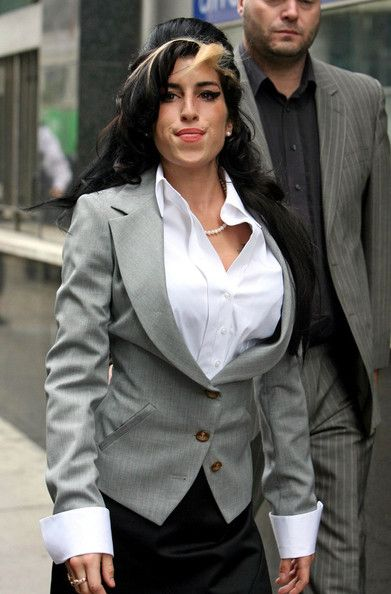 Amy Winehouse Photos Photos - Singer/songwriter Amy Winehouse heads into the City of Westminster Magistrates Court for the second day only to be found not guilty of assault charges stemming from an altercation at a charity ball last September. The usually troubled singer has kept her fashion together, dressing to impress the court, but following the hearing Winehouse opts to change into more comfortable attire as she leaves. - Amy Winehouse 1983 - 2011