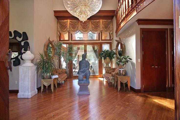 Contemporary Hallway with Hardwood floors, Balcony, Life Size Kneeling Chinese Figurine Terracotta Warrior, High ceiling