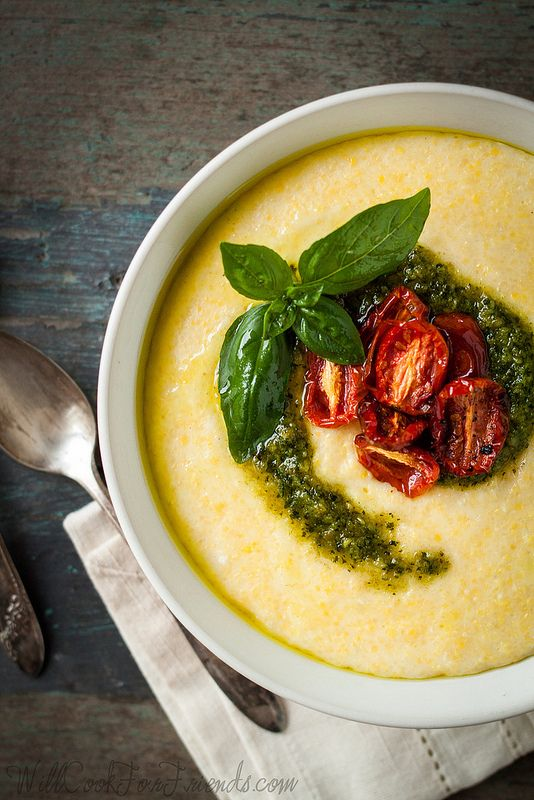Creamy Cheddar Polenta with Pesto & Oven-Roasted Tomatoes   31 Cuddly And Delicious Beds Of Polenta