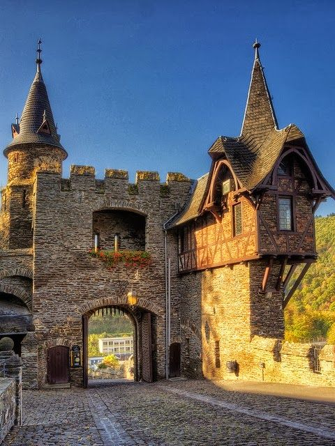 Reichsburg Castle above Cochem on the Mosel River, Germany - the original castle was built in the year 1000. It was destroyed during the occupation by the troups of Louis XIV and rebuilt in the Neo-Gothic style in the early 19th century. Visitors can enjoy a guided tour and a medieval feast.