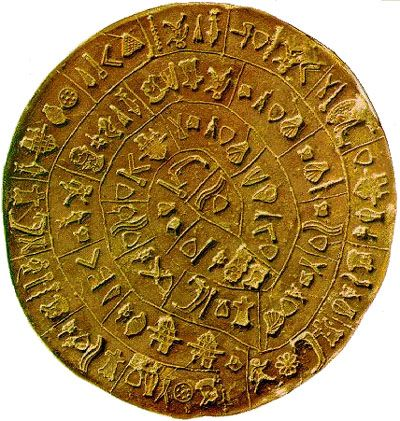 Phaistos Disc, Minoan, Middle Bronze Age (1900 - 1600 BC), British Museum.  Found by Italians in the 1930s.  Evans had lots of writing from Knossos and this found in Phaistos, the writing has no parallels.  Symbols in a spiral - suppose to be new palace period, none have found anything like it since.  Many believe it is all types of things, but has no similarities.
