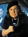 Anne Ramsey (September 1, 1929 - August 11, 1988) is a character actress known mostly for two famous roles as mothers, the first as Mama Fratelli in The Goonies, and the second as Momma Lift in Throw Momma From The Train. Train was an homage paid to the Master of Suspense, Alfred Hitchcock, a remake [of sorts] of his 1951 classic Strangers On A Train, which starred Farley Granger, Robert Walker, Ruth Roman, Leo G. Carroll, and Hitchcock's own daughter Patricia. Sadly,Anne Ramsey died of…