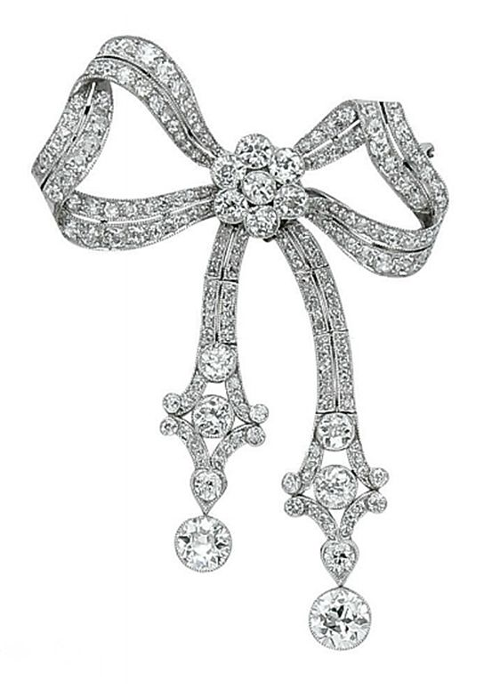 A DIAMOND AND PLATINUM BOW BROOCH, ~Latest Luxurious Women's Fashion - dresses, jackets. bags, jewellery, shoes etc