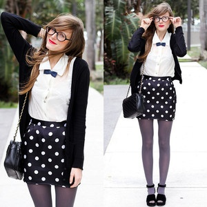 black and white polka dot skirt, white shirt, black cardigan and shoes and grey tights outfit