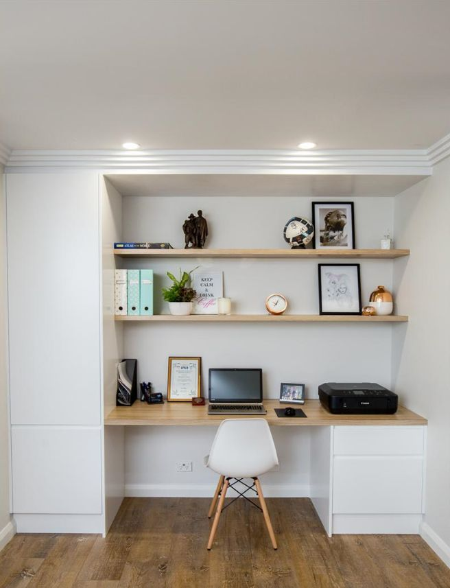 small home office tucked into a family room or bas…