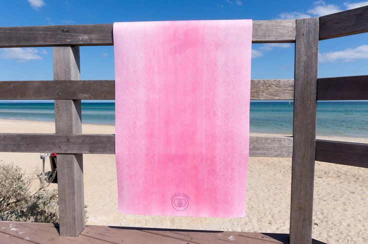 Beach side yoga practice taken to a new level... pick pink!
