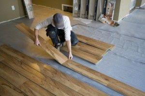 Waterproof vinyl planking for floor no glue installation wood floor look keeps floor light and low maintence.